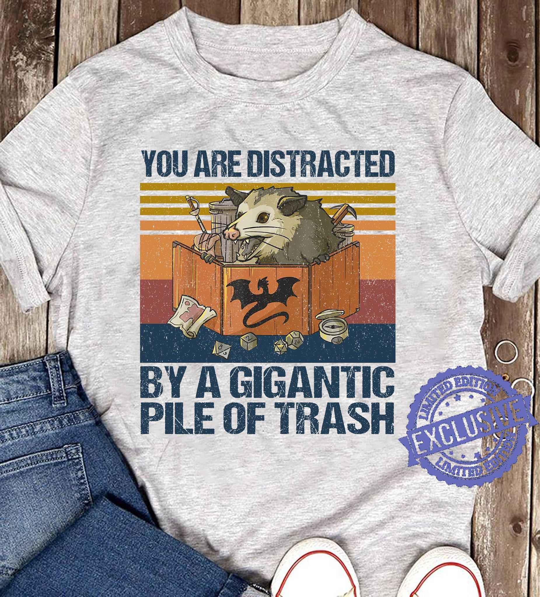 You are distracted by a gigantic pile of trash shirt